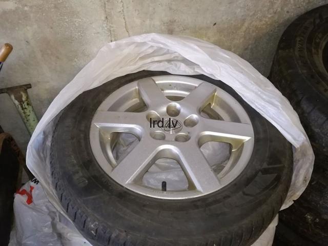 Toyota Avensis lietie diski R15 ar ms riepām